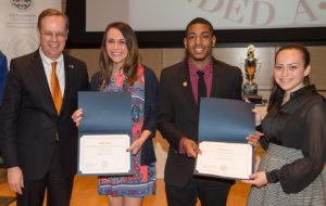 Chancellor Syverud with three award recipients